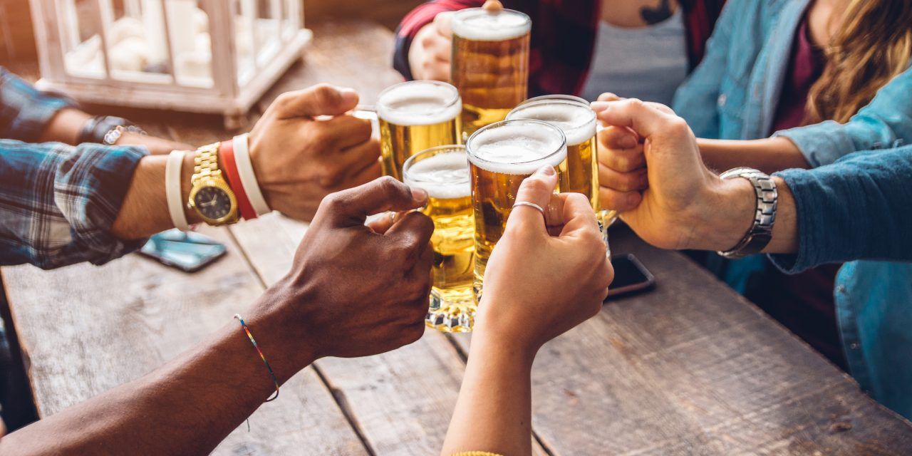 https://www.atlantivacations.com/wp-content/uploads/2020/11/group-people-enjoying-toasting-beer-brewery-pub-friendship-concept-with-young-people-having-fun-together-1280x640.jpg